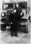 Shie Zoltak poses with his cousin, Chana Lisogurski, next to an UNRRA truck in the Cremona DP camp.