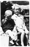Two young Jewish children who survived the war in hiding, sit on a park bench in Ludbreg, Croatia.