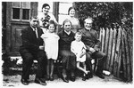 The Kejles family poses outside its home in Grodzisk.