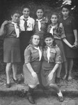 Group portrait of girls wearing the uniform of a Zionist youth movement in the Selvino children's home.