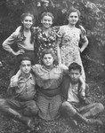 Group portrait of five adolescents in the Selvino children's home.