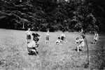 Children play at tug-of-war in the Chateau de la Hille.