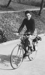 Peter Salz rides a bicycle after fleeing to Switzerland from France.