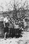 """""""Les Moyens"""" (the middle group) boys pose with the older girls in the children's home in Seyre."""
