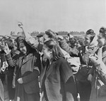 Female survivors greet British liberators in Bergen-Belsen.