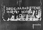 "Anti-semitic graffiti painted on the window of a Jewish business reads: ""The Jewish parasite sold Norway on the 9th of April [the date of the German invasion in 1940]."""