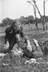 A ten-year-old Polish girl named Kazimiera Mika, mourns the death of her older sister, who was killed in a field in Warsaw during a German air raid.