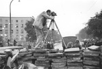 American photographer Julien Bryan films a scene duing the siege of Warsaw.
