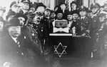 Chief Rabbi of the Polish Army, Boruch Steinberg poses with a group of Polish officers in a Krakow synagogue.