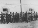 Members of the camp orchestra perform in front of a barracks in the Janowska concentration camp.