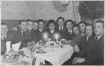 Szulim Bronner's friends gather around him to celebrate his wedding to Hela Kolin in the Weiden displaced persons camp.