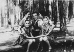 A group of children pose together in a forest near Olkusz.