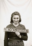 Halina Bryks holds a name card intended to help any of her surviving family members locate her at the Kloster Indersdorf DP camp.
