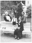 Dov Zugman rests on a park bench with his mother and some of her friends.