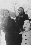 Agnes and Zsuzsi Laszlo build a snowman outside their mother's pension in Miskolc.