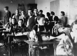 Jewish men and women working in a sewing workshop in the Olkusz ghetto.