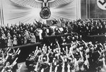 "Hitler receives an ovation from the Reichstag for the ""Anschluss"" with Austria."