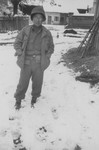 A Japanese-American soldier with the 522nd Field Artillery battalion poses outside in the snow in Waakirchen, Germany.