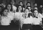 Members of the Dror Zionist youth choir perform at a Hanukkah celebration in the Landsberg displaced persons camp.