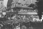 Thousands attend a rally celebrating the founding of the State of Israel, outside the headquarters of the Central Committee of the Liberated Jews in the US Zone of Germany located on the Moehlstrasse in Munich.