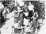 A group of girls shake hands outside the Selvino children's home.