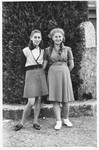 Two teenage girls pose together on the grounds of the Selvino children's home.