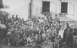 Group portrait of students and teachers in a newly opened Jewish school in Vilna.