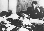 Varian Fry seated at his desk in the offices of the Centre Americain de Secours.