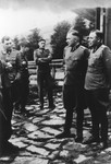 Nazi officers stand on a terrace of Solahuette, the SS retreat outside of Auschwitz.