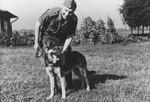 SS officer Karl Hoecker pets his dog, Favorit.