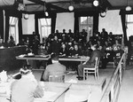 View of the courtroom and proceedings of the first Dachau trial.