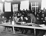 Chief defense attorney, Douglas Bates, examines evidence with his co-counsel in the first Dachau trial.