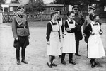 SS officers and German nurses gather during the dedication ceremony of the new SS hospital in Auschwitz.