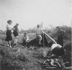 Jewish scouts set up a tent and prepare a meal during a camping trip to the Hunjow cemetery in Shanghai.