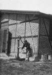 A Jewish forced laborer pumps water in a farm in Osterburg, Germany.