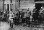 Group portrait of Nazi officers standing in front of a building in Solahutte, the SS retreat outside of Auschwitz.