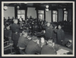 Officers of the court are sworn in at the Dachau Trial.